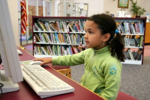 Child in a school library